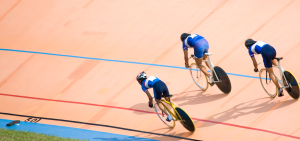 Image of cyclists on velodrome track